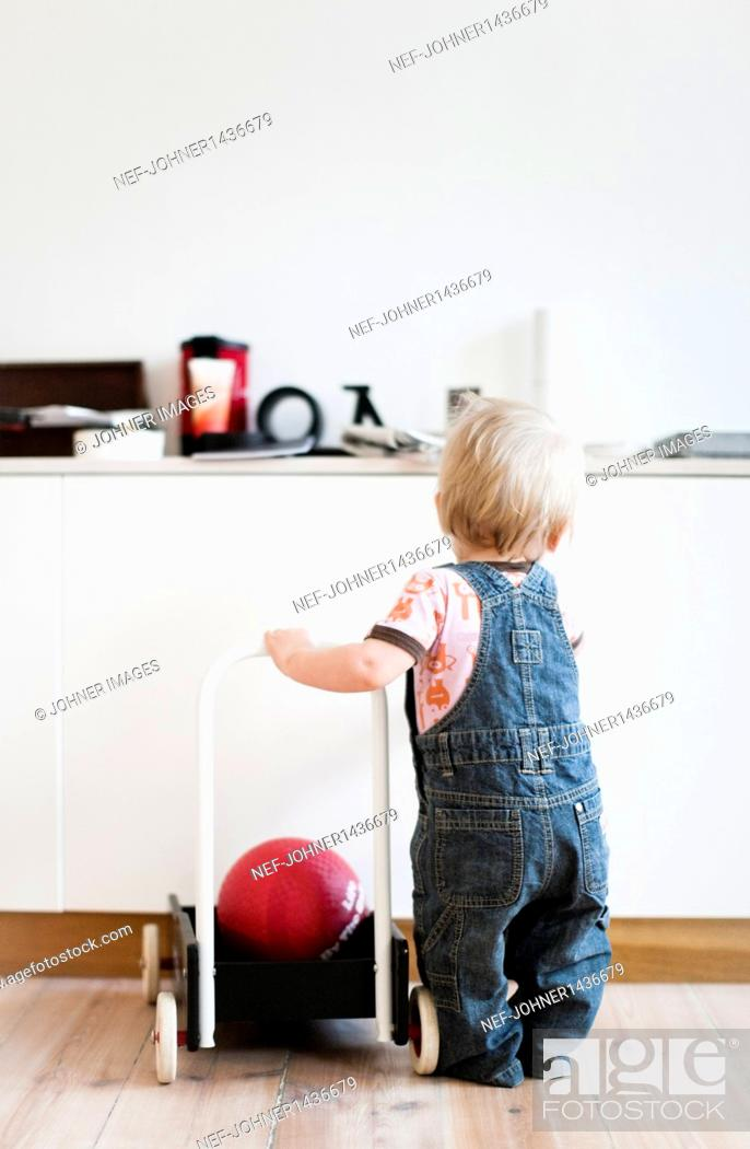 Stock Photo: Baby boy playing at home.