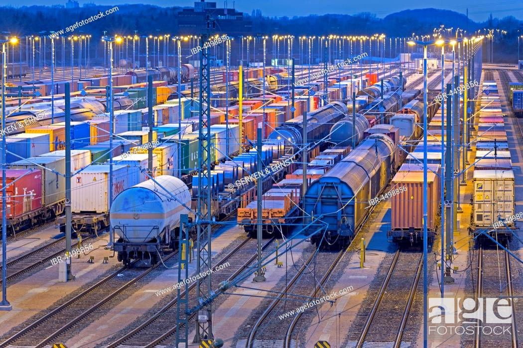 Stock Photo: Parked freight cars on tracks at night, marshalling yard Maschen, Maschen, Lower Saxony, Germany.
