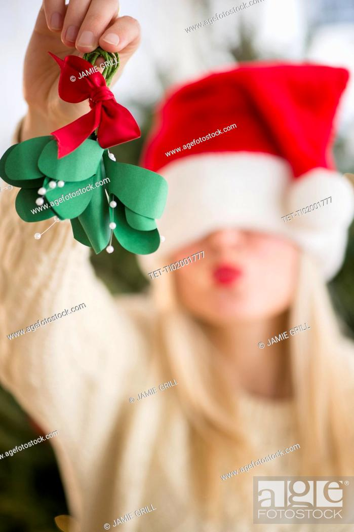 Stock Photo: Woman colding christmas decoration.