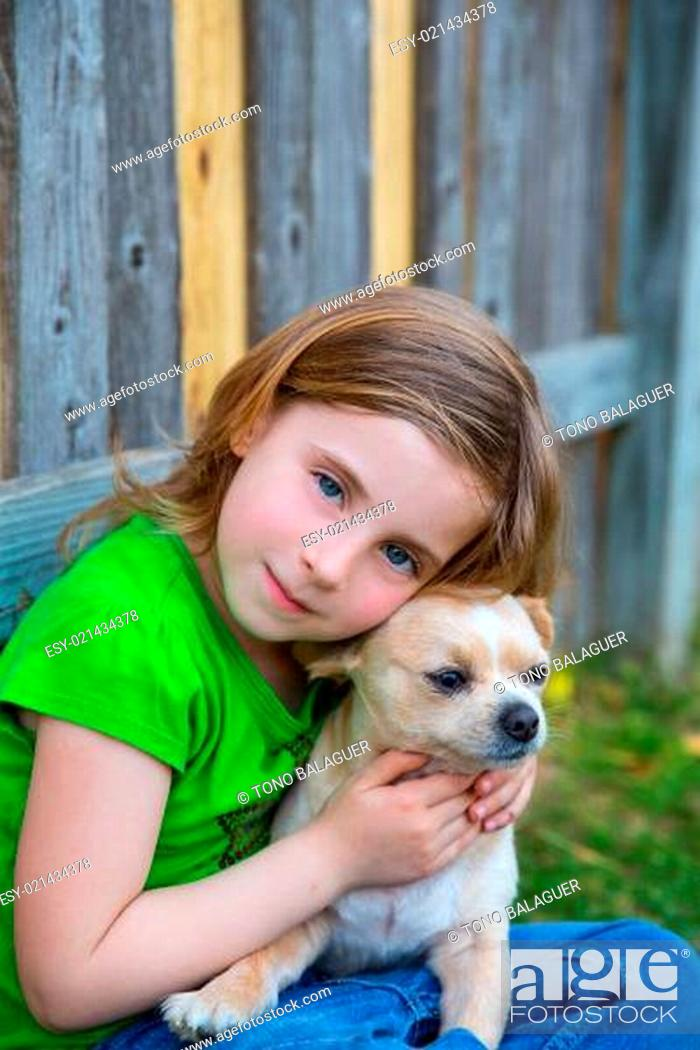 Stock Photo: Blond happy girl with her chihuahua doggy portrait.