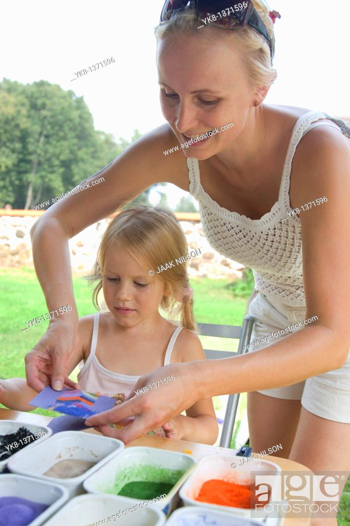 Stock Photo: Four Year Old Young Kid Girl with Mother Working with Color Sand in Art Class.