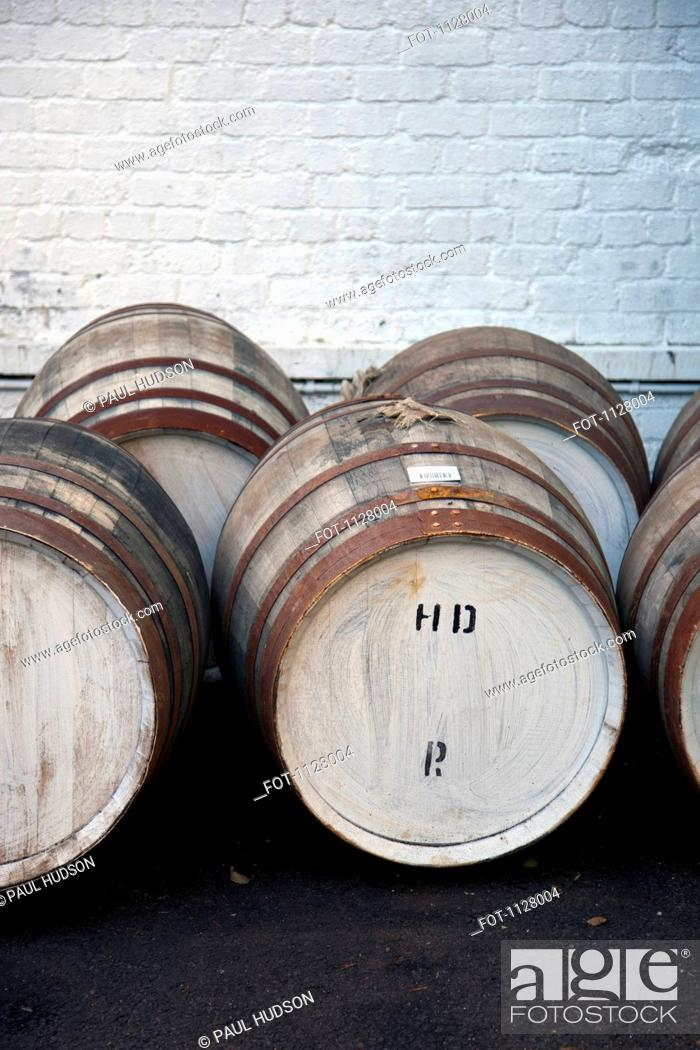 Stock Photo: Wooden barrels at a whiskey distillery.