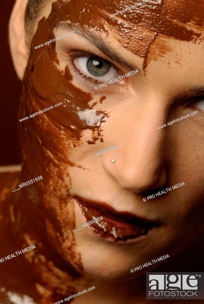 Stock Photo: Natural cosmetics : chocolate - face of a young woman.