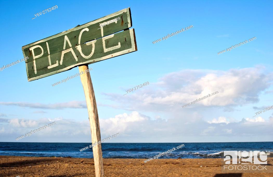 Stock Photo: Signpost on a beach. The word ''plage'' ( i. e. beach in french language) is written on the signpost. At Mananjary ( Madagascar).