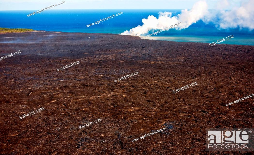 Stock Photo: Lava Flow and Steam Plume.