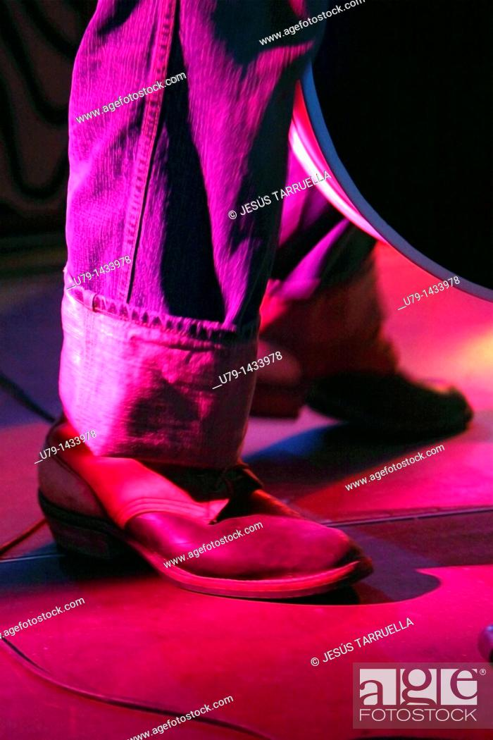 Stock Photo: Boot Rock and Roll musician.