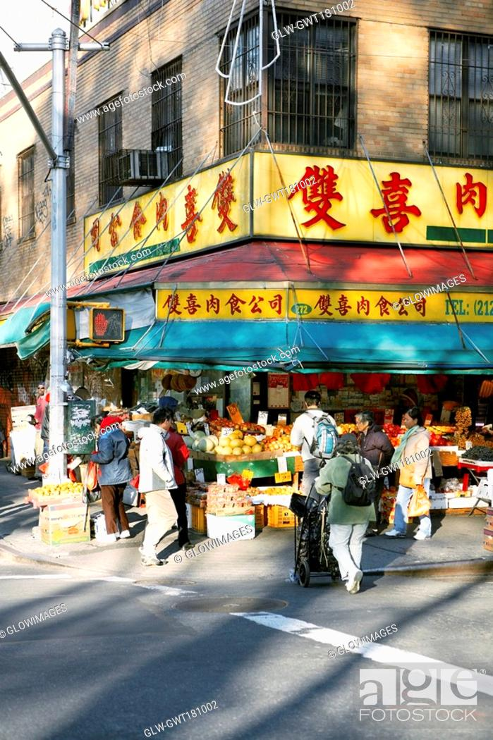 Stock Photo: Group of people in a fruit market, Chinatown, Manhattan, New York City, New York State, USA.