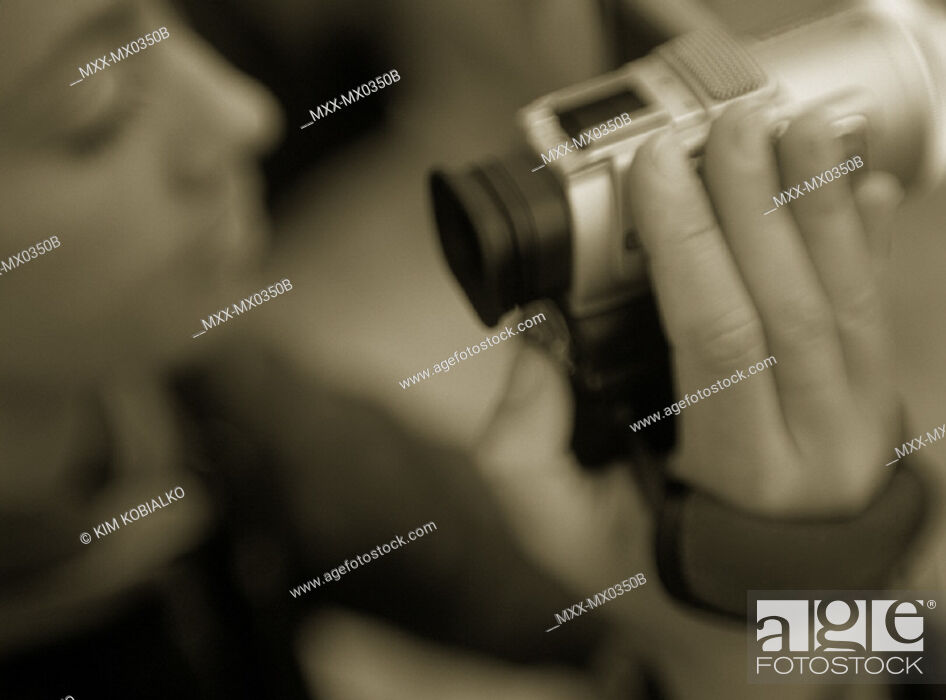Stock Photo: Woman holding camera.