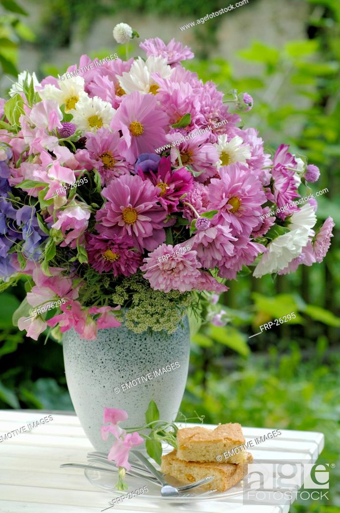 Stock Photo: Bunch of flowers on garden table.