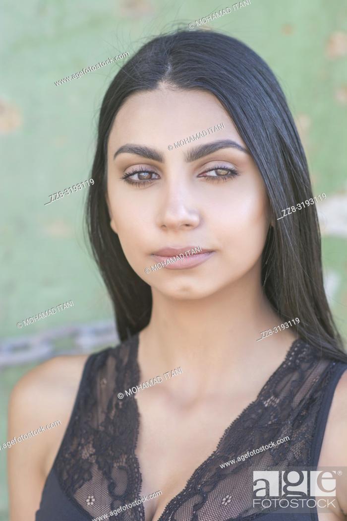 Stock Photo: Beautiful young woman looking away outdoors.