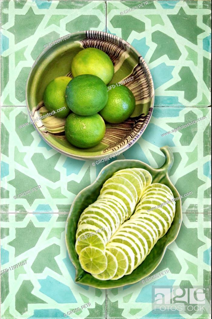 Stock Photo: Limes, whole and sliced.