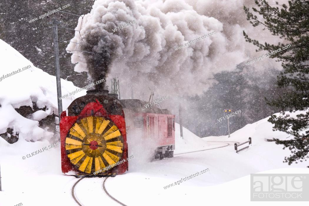 Stock Photo: Steam of the snowplow of the Bernina Express train, Morteratsch, canton of Graubünden, Engadin Valley, Switzerland.