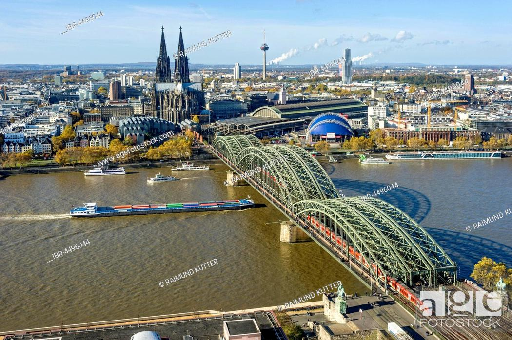 Stock Photo: View over the river Rhine, Cologne's historic centre, Cargo Ship, Museum Ludwig, Cologne Cathedral, Hohenzollern Bridge, Central Station, Musical Dome.