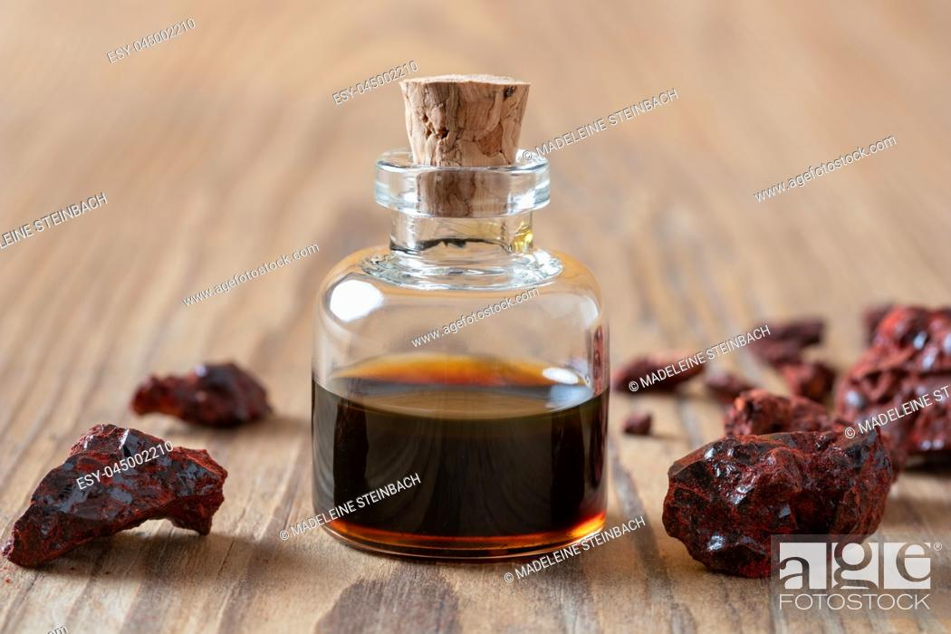 Stock Photo: Croton lechleri or sangre de drago resin and oil on a table.
