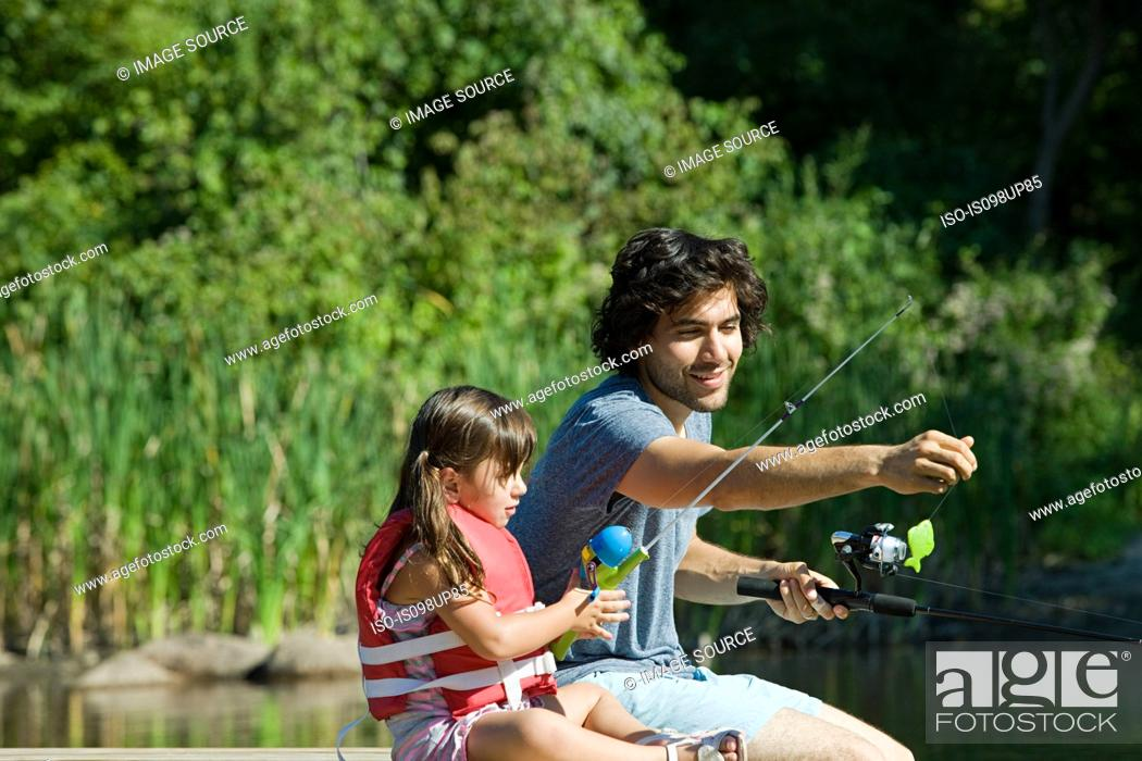 Stock Photo: Father and daughter fishing.