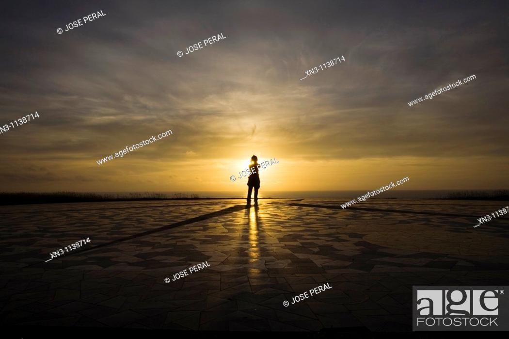 Stock Photo: Woman at sunset in Compass Rose (Rosa de los Vientos)Next to Hercules Tower, La Coruna, A Coruña, Galicia, Spain.