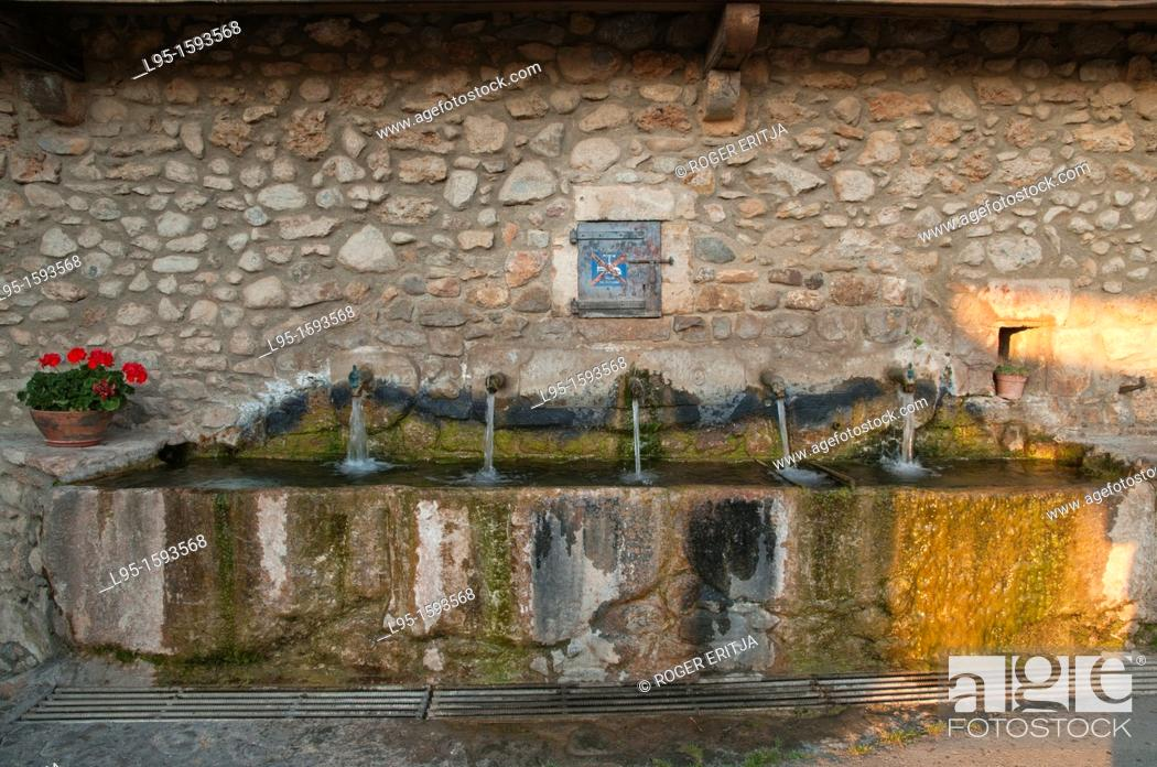 Stock Photo: Public fountain from beginnings of the XXth century in a small village of the Cerdanya village in Pyrenees, Spain.