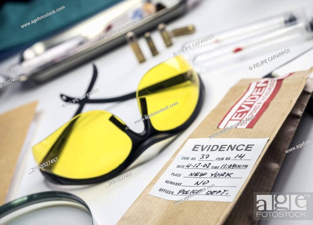 Stock Photo: Hypothetical evidence bag with sample of a murder in a crime lab, conceptual image.