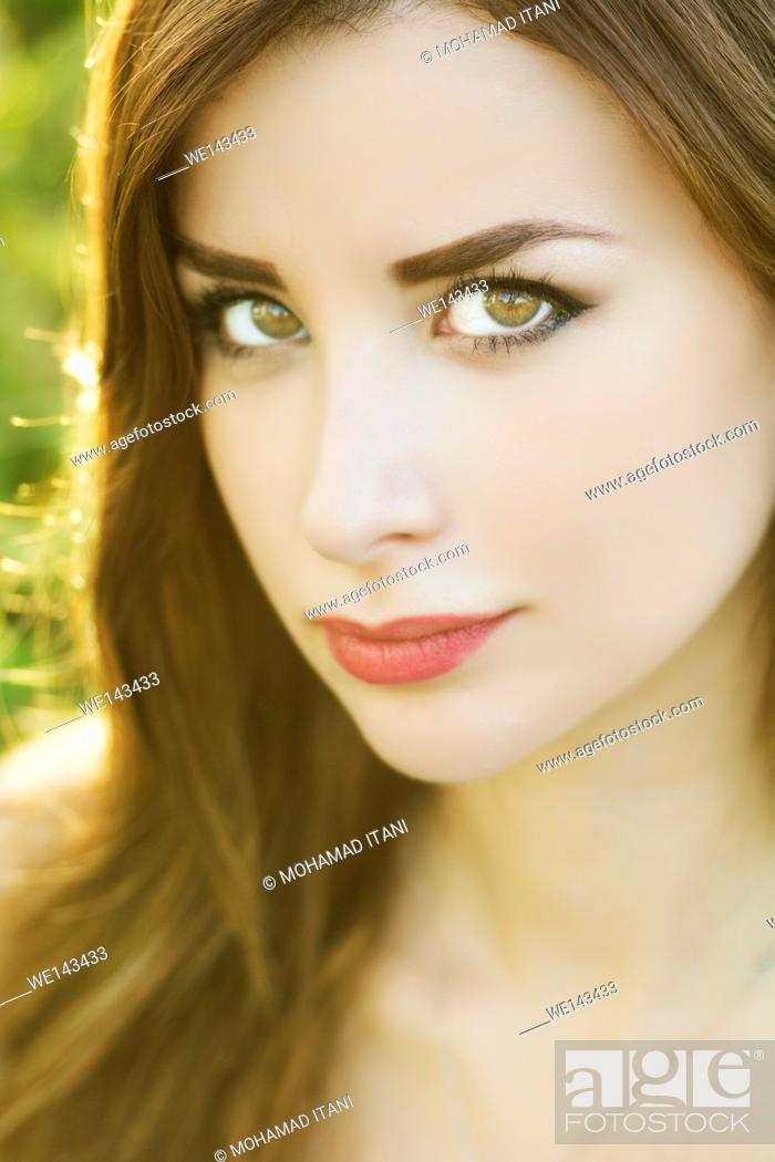 Stock Photo: Beautiful young woman outdoors.