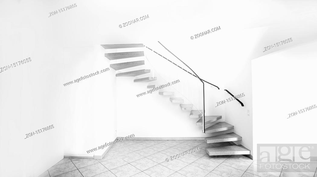 Stock Photo: twisted staircase in clean white building leading up to second floor with white walls.
