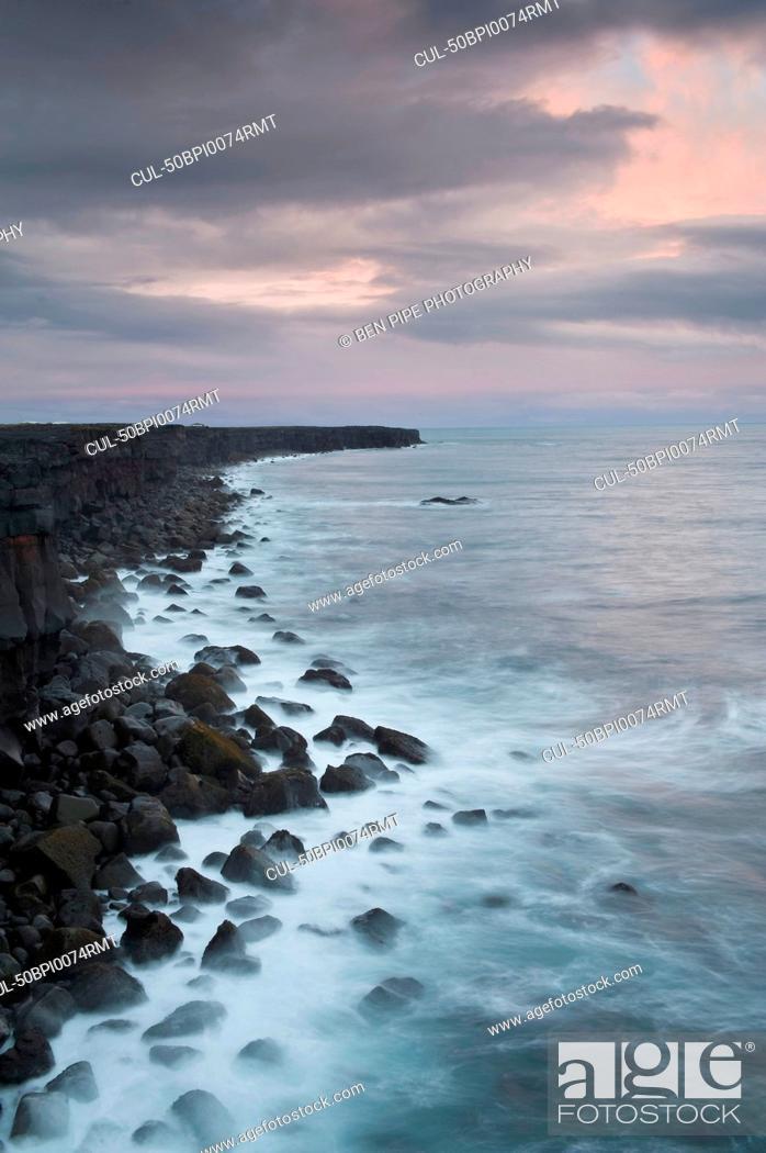 Stock Photo: Waves washing up on rocky coastline.