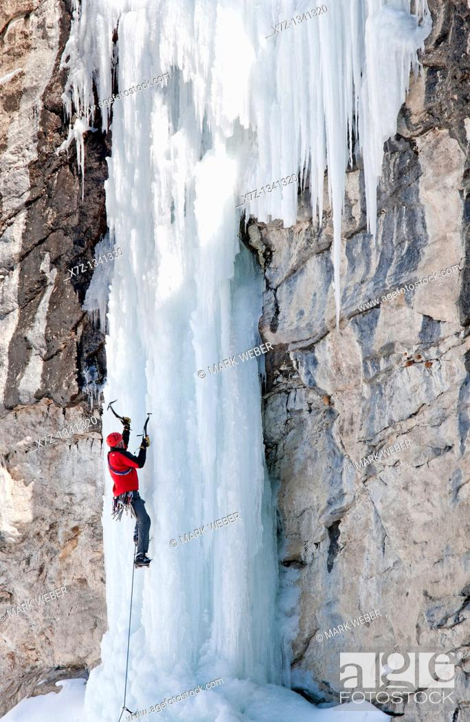 Stock Photo: Man ice climbing a route called The Boy Scout which is rated WI,4 and located in Lamoille Canyon at The Ruby Mountains in northeastern Nevada.
