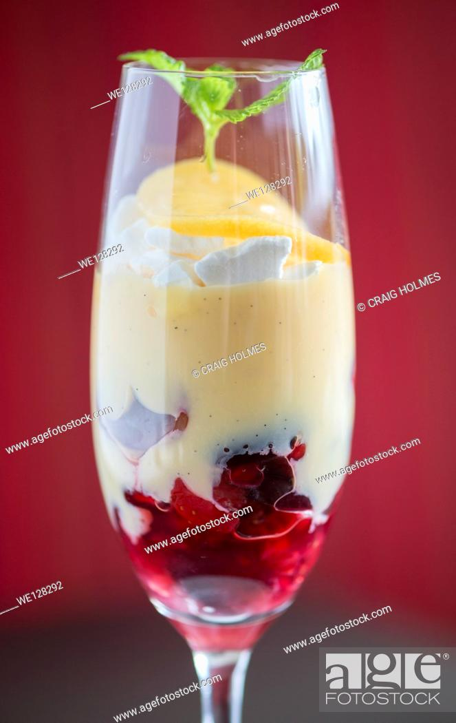 Stock Photo: Trifle in a wine glass dessert from a fine dining restaurant.
