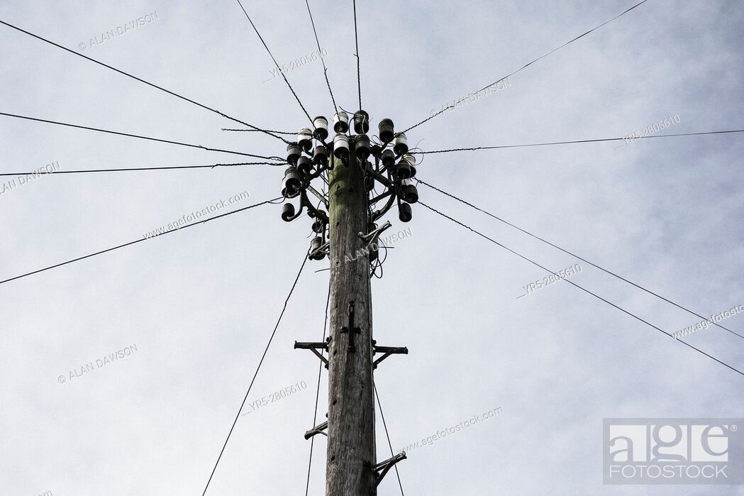 Stock Photo: Telegraph pole and telephone lines in street in England. United Kingdom.