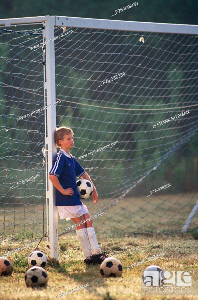 Stock Photo: Boy on soccer field.