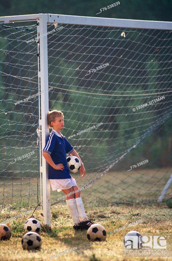 Stock Photo: Boy on soccer field.