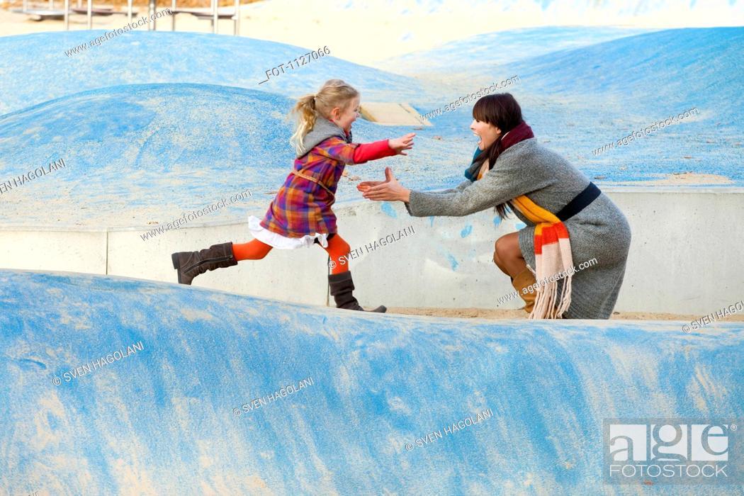Stock Photo: Daughter runs towards Mother in park.