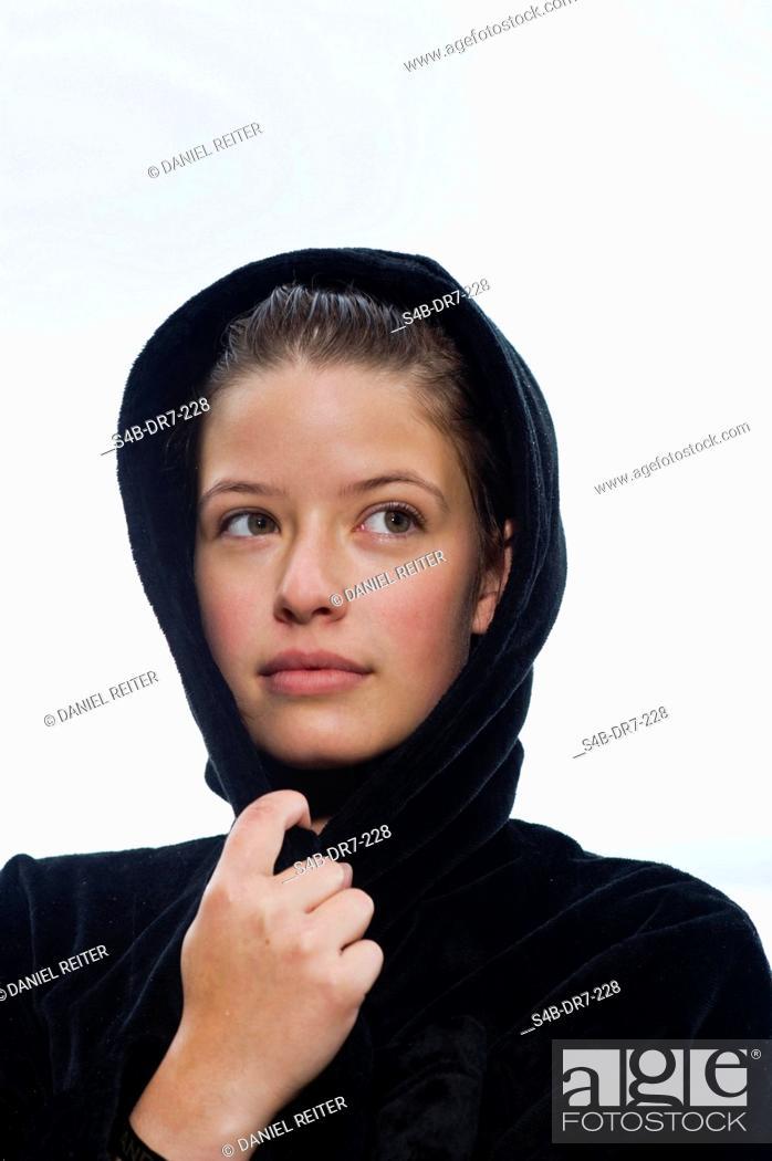 Imagen: Woman with wet hair in bathrobe, Lake Starnberg, Bavaria, Germany.