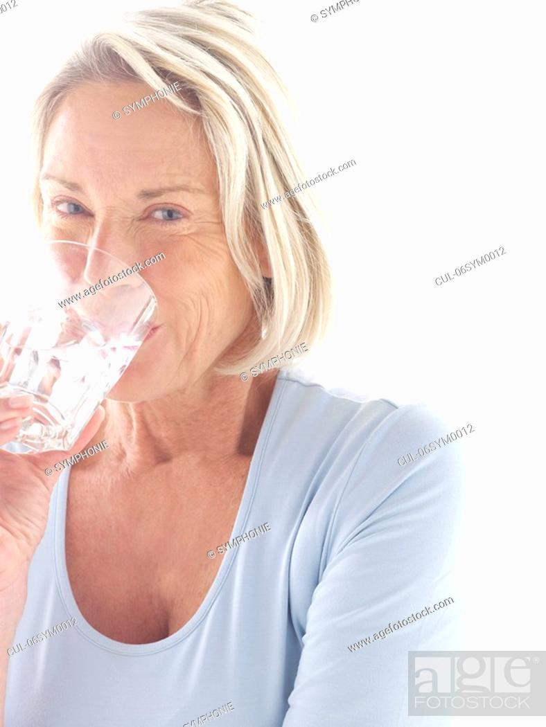 Stock Photo: Mature woman drinking water.
