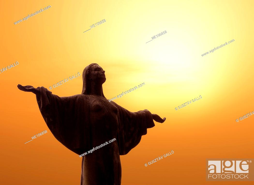 Stock Photo: The light is spreading towards the sculpture's hand.