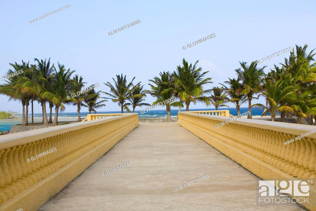 Stock Photo: Bridge leading towards the beach, Dixon Cove, Roatan, Bay Islands, Honduras.