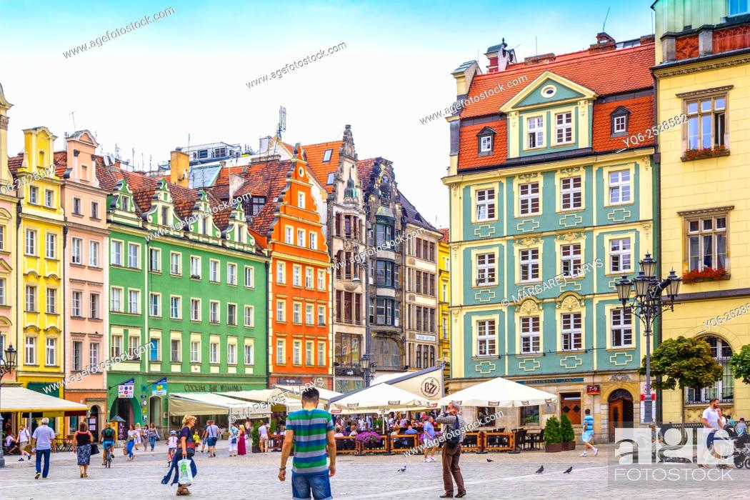 Stock Photo: People walking in the Old Town, Market Square, Wroclaw, Poland, Europe, Summer 2015.