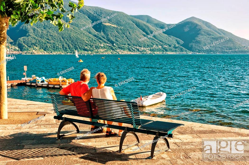 Stock Photo: Couple sitting on the bench at the promenade of the luxurious resort in Ascona on Lake Maggiore, Ticino canton, Switzerland.