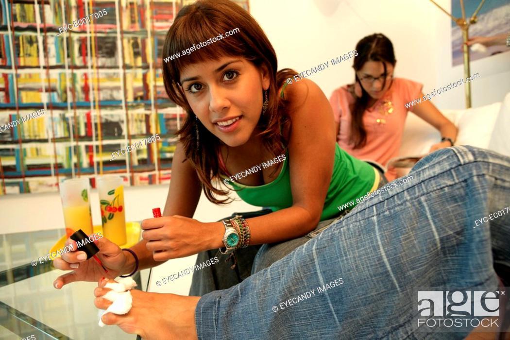 Stock Photo: View of a woman applying nail polish.