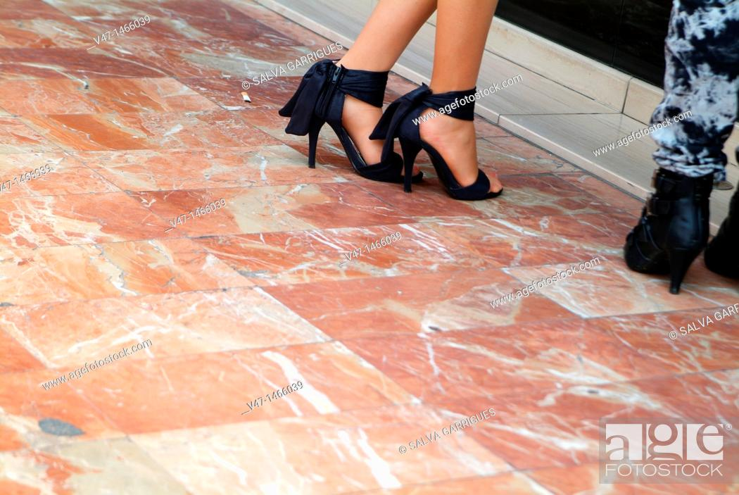 Stock Photo: heeled shoes on red marble.