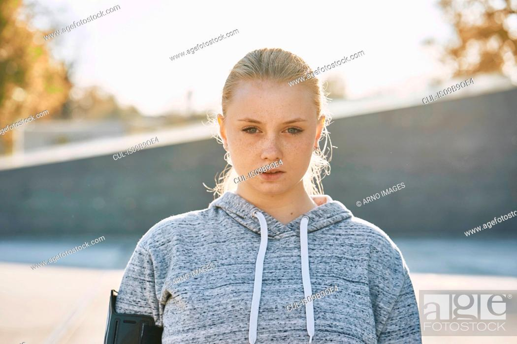 Stock Photo: Young woman training, backlit portrait.
