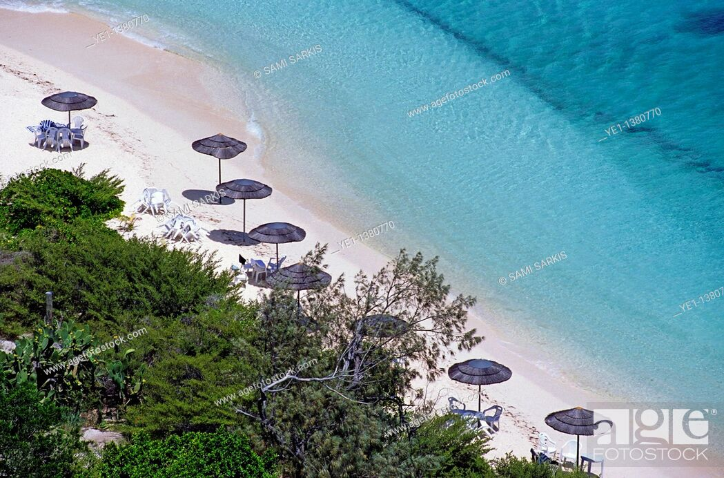 Stock Photo: Sun umbrellas dotted along the white sand beach on Amedee Island, New Caledonia.