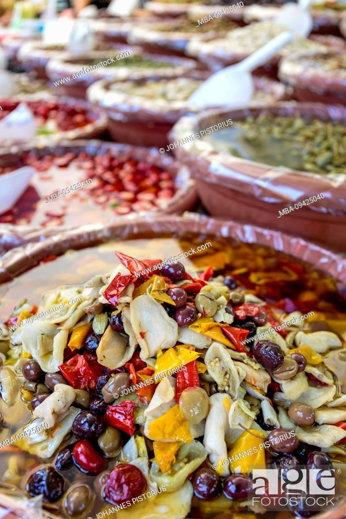 Stock Photo: Europe, Italy, Piedmont, Cannobio. Jugs with antipasti at the stall of a trader at the weekly market.