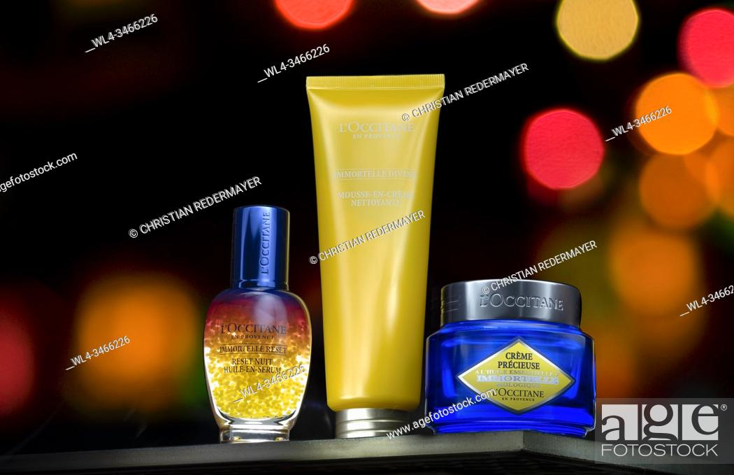 Stock Photo: Cosmetics in painted with light in front of a bokeh background.