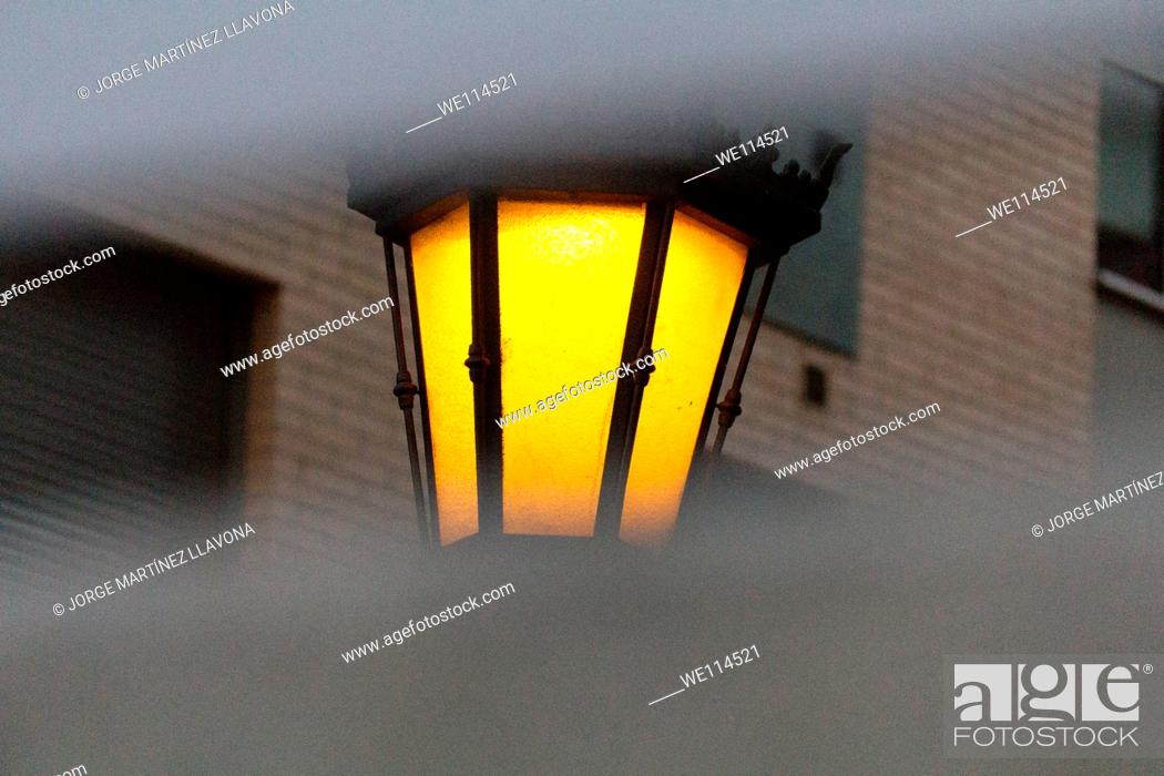 Stock Photo: Streetlight and building.