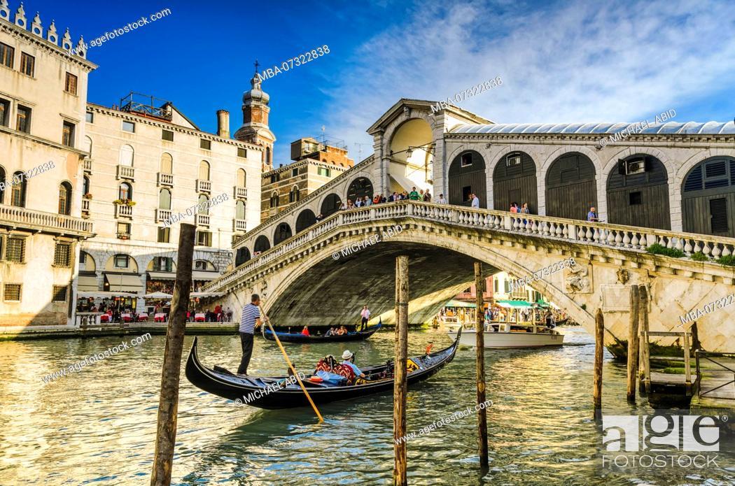 Stock Photo: Gondola at the Rialto bridge with evening light in Venice, Italy.