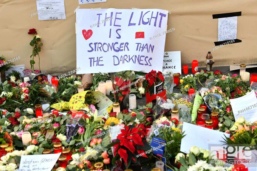 "Stock Photo: A sign reads """"The light is stronger than the darkness"""" near the site of the attack at the Christmas market at Breitscheidplatz in Berlin, Germany."