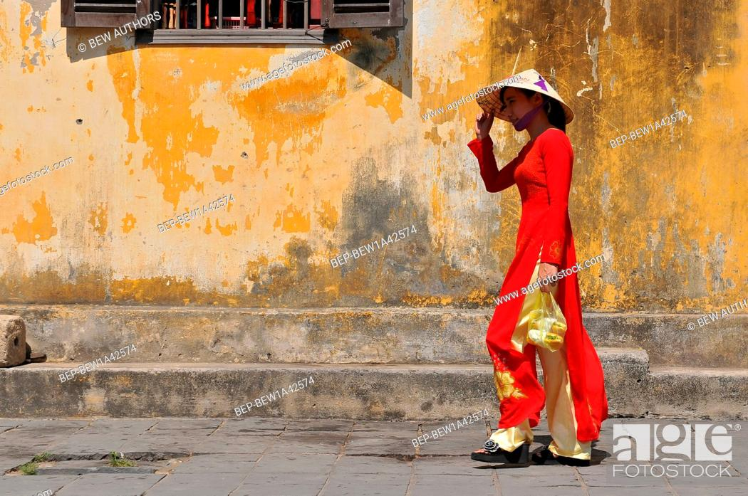 Stock Photo: Vietnam, Hoi An, Vietnamese women in traditional dresses, Hoi An.