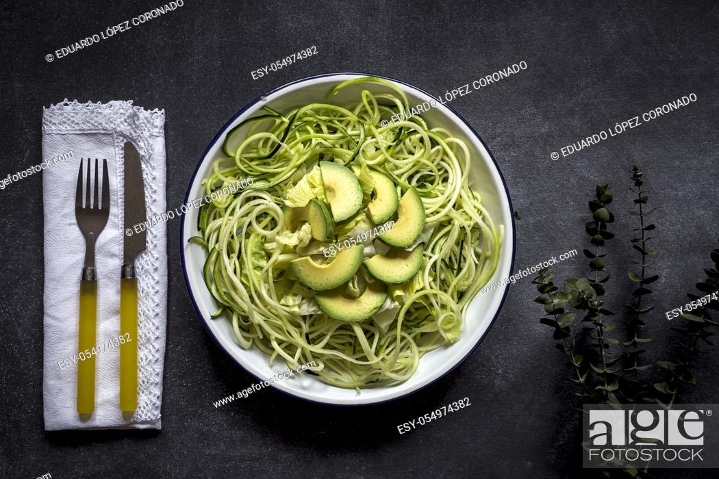Stock Photo: Fresh zucchini on a black background on old table.