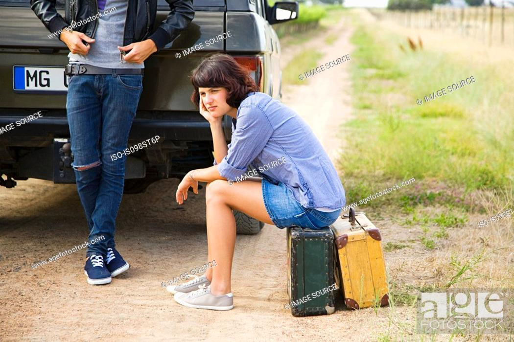 Stock Photo: Couple waiting by suv.