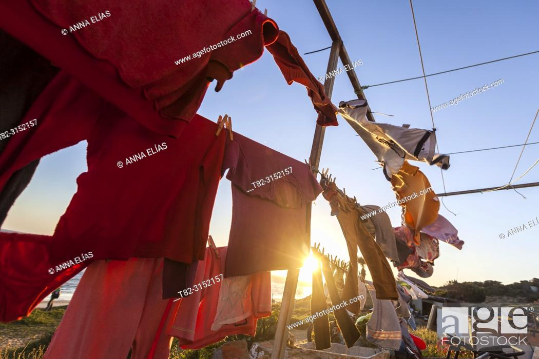 Stock Photo: clean clothes drying in the sun and wind with sea in the background, Matalascañas, Huelva, Andalucia, Spain, Europe.